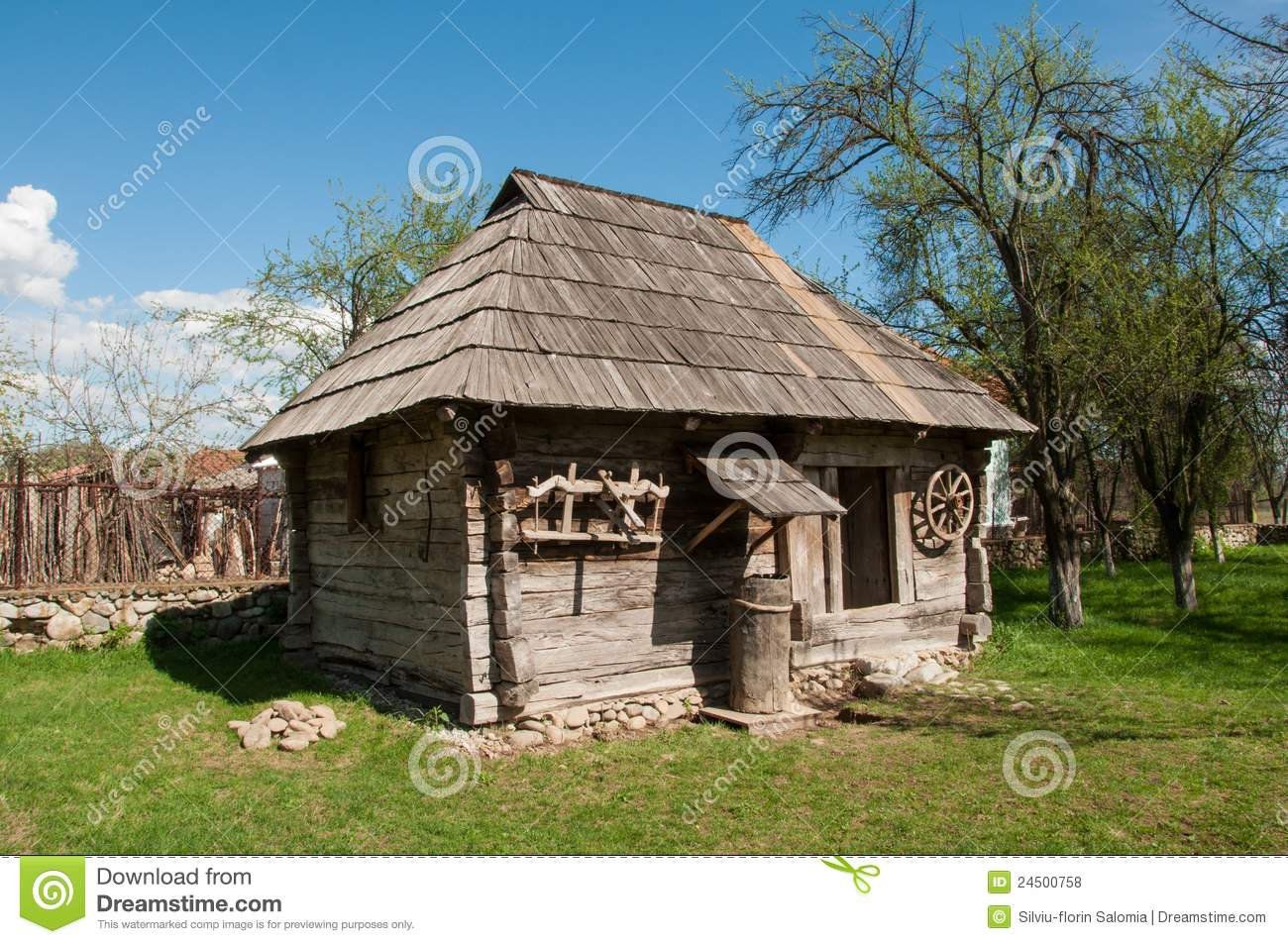 Small Wooden Traditional House In Romanian Village Stock