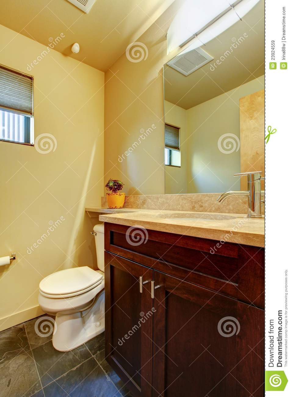 Small yellow bathroom with wood stock image image 23924559 for Small bathroom yellow