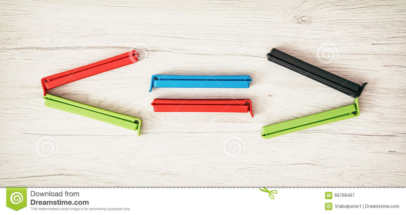 Smaller-than, greater-than and equal sign of colorful bag clips