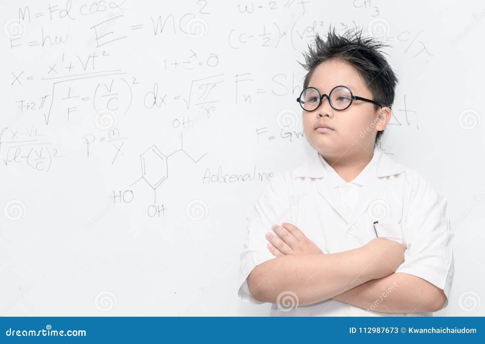 Smart asian scientist boy on whiteborad