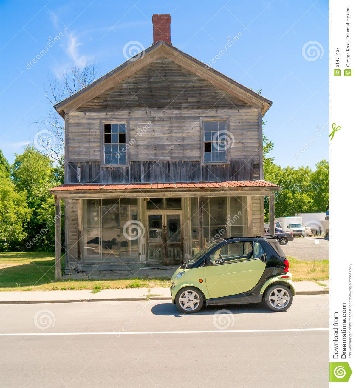 Smart Car In Front Of Old Wooden House Royalty Free Stock