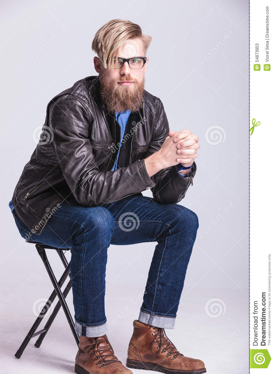 Smart Casual Blond Man Sitting On A Chair Stock Image