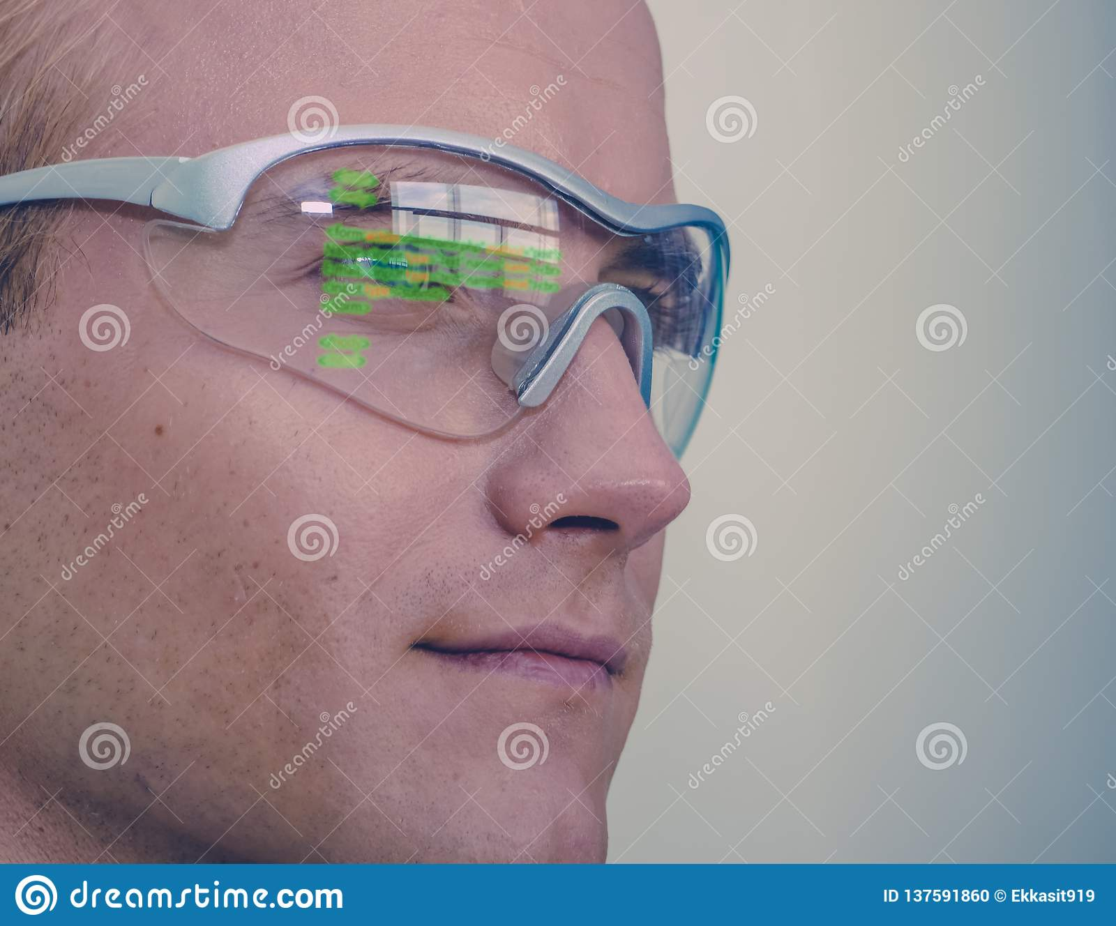 Smart glasses futuristic technology concept, man wear smart glasses with augmented reality to Managing field service and assembly,