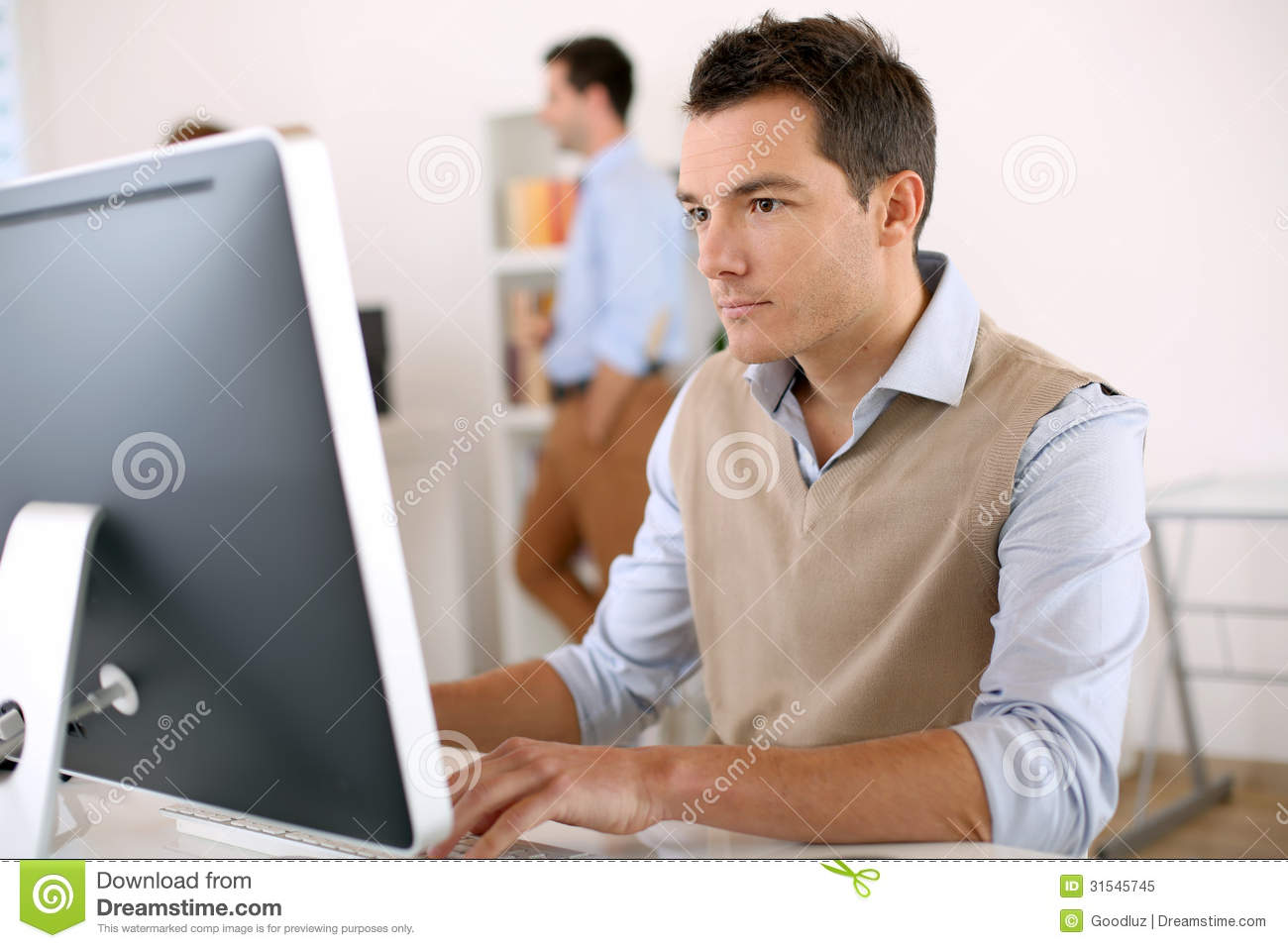 Smart Guy Working In Office Royalty Free Stock Photo - Image: 31545745