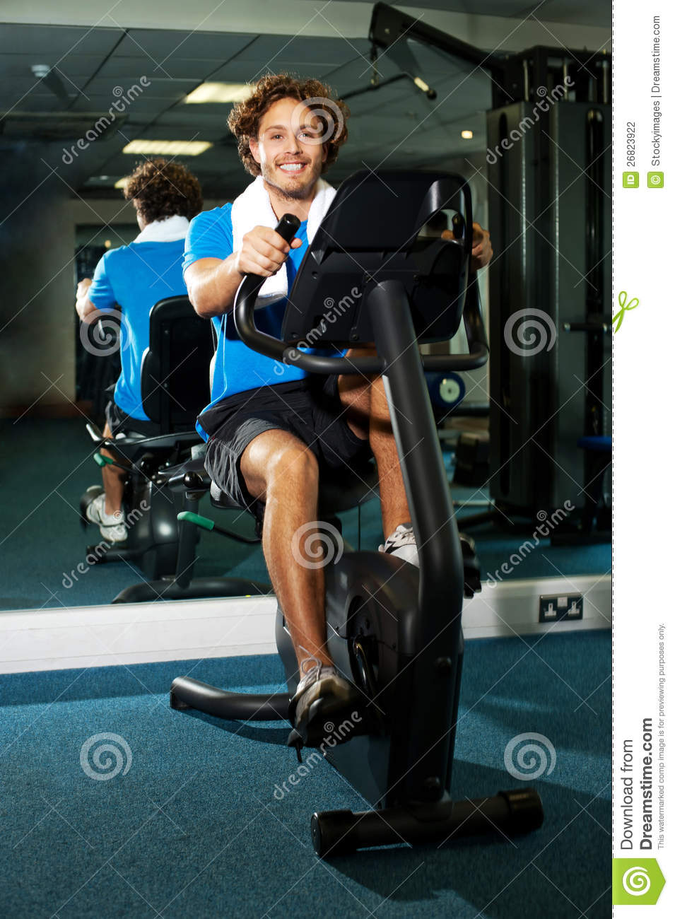 Smart Guy Working Out In The Exercise Bike Stock Photo - Image of