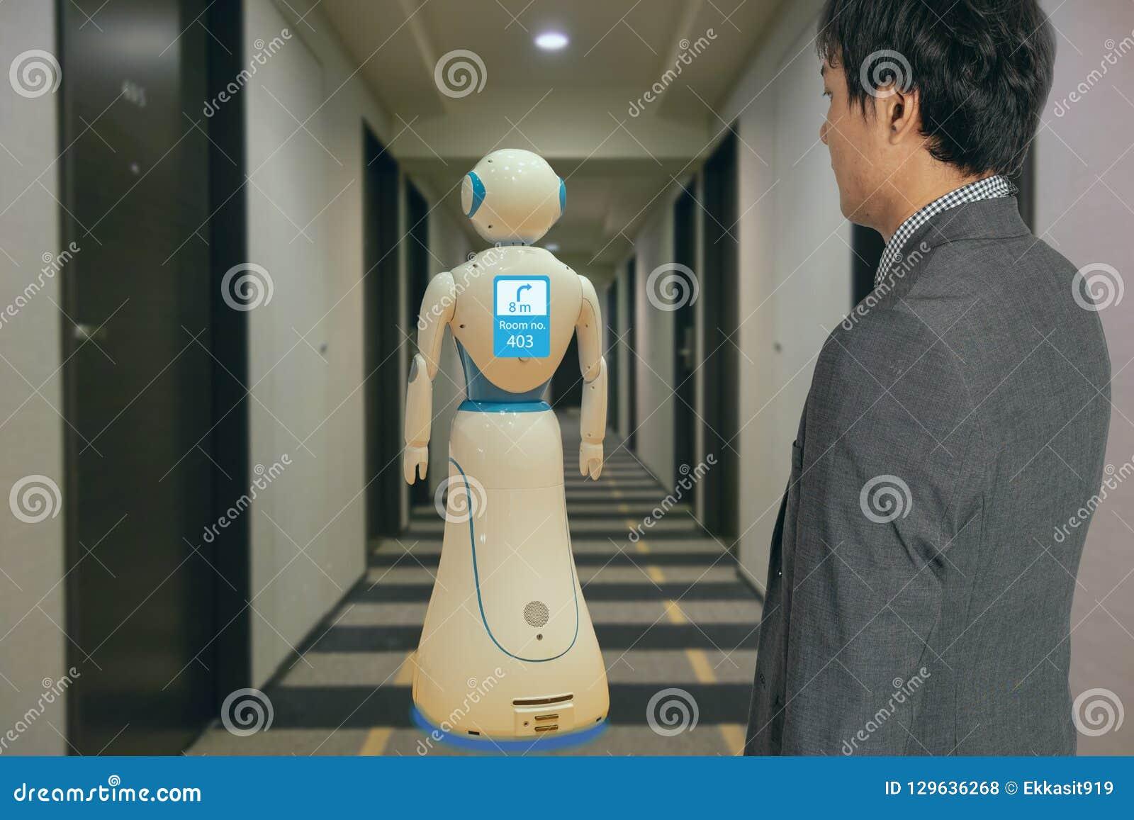 Smart hotel in hospitality industry 4.0 technology concept, robot butler robot assistant use for greet arriving guests, deliver cu