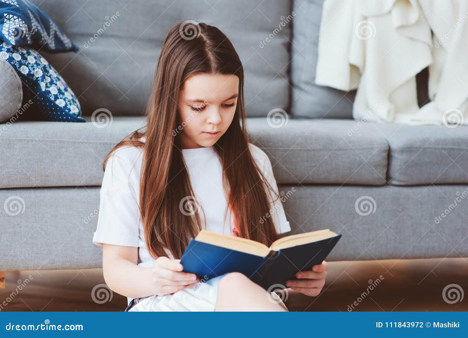 smart kid girl reading interesting book
