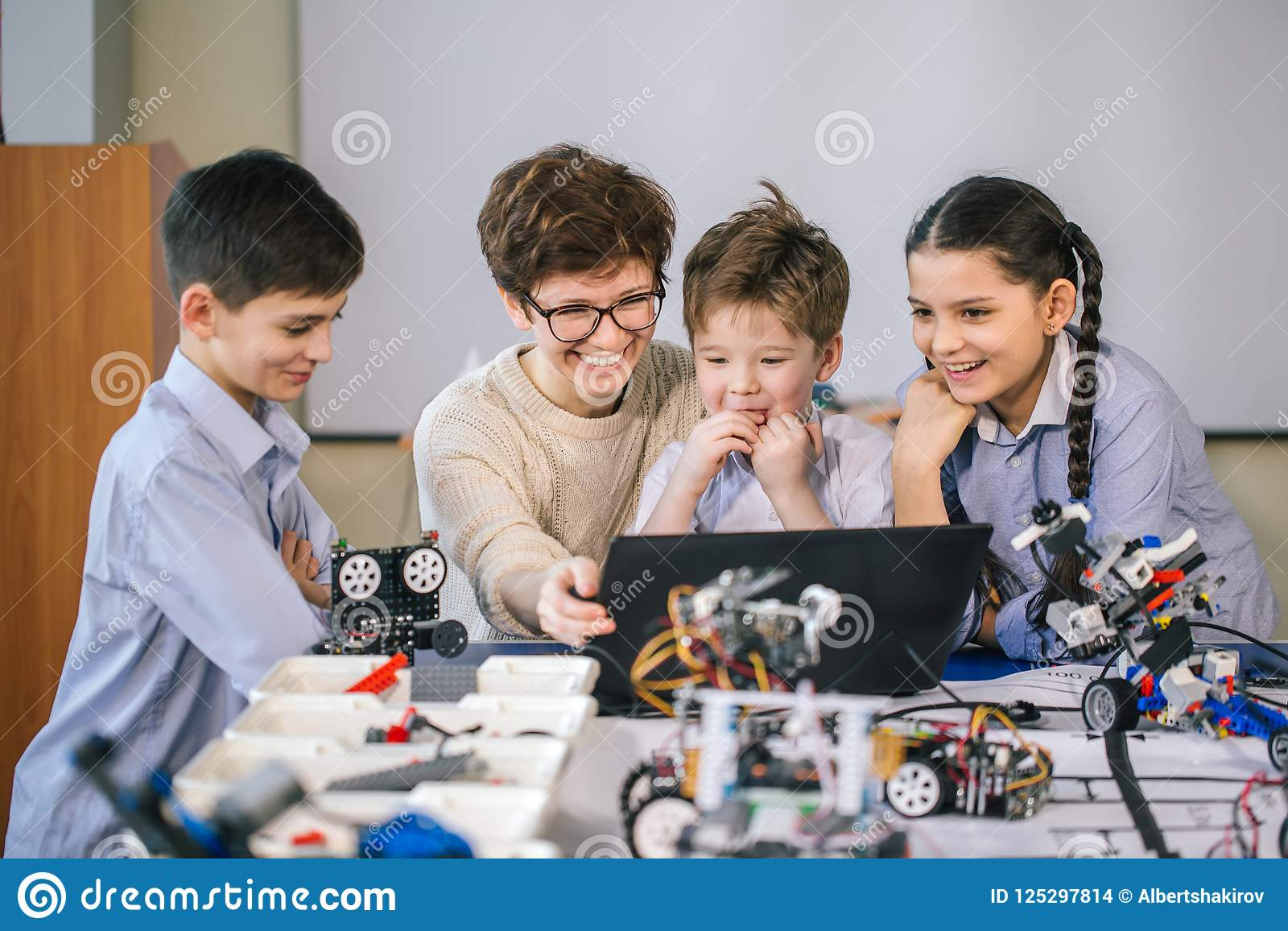 Curious Children Learn Programming Using Laptops On Extracurricular Electrical Wiring Classes Download Stock Photo Image Of Advertising