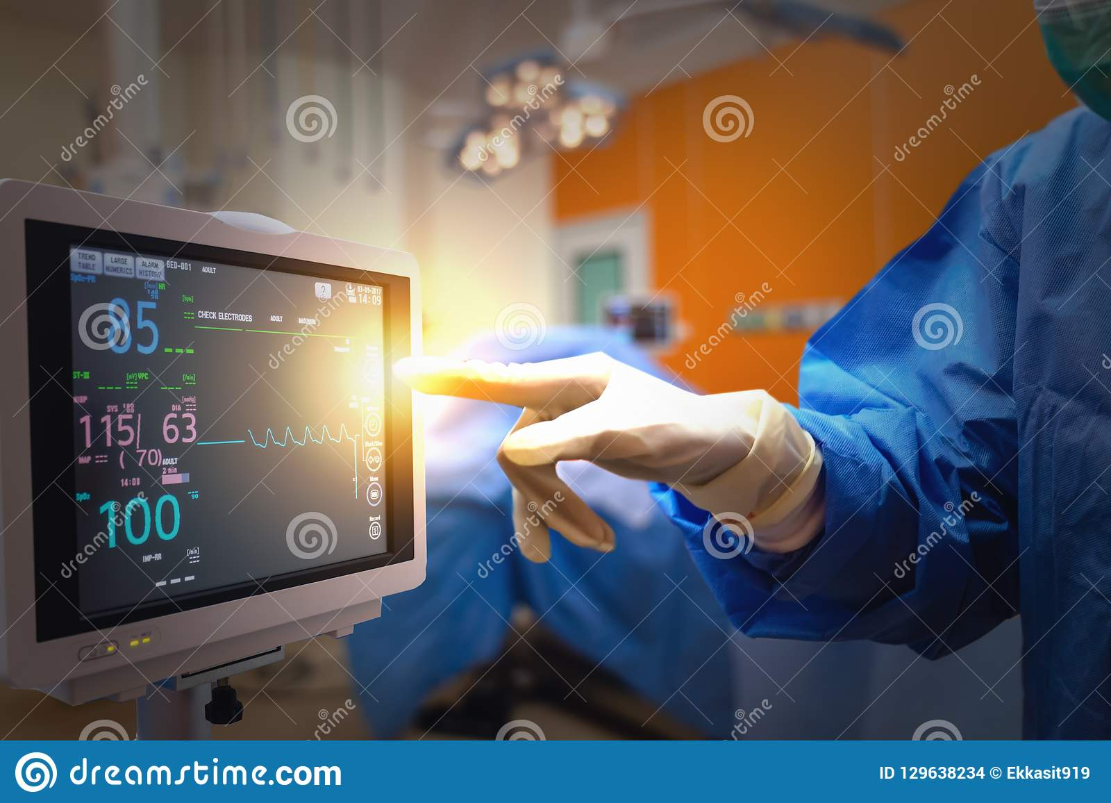 Smart medical technology in hospital concept, doctor in Surgeons team field holding medical instruments for surgery the patient in