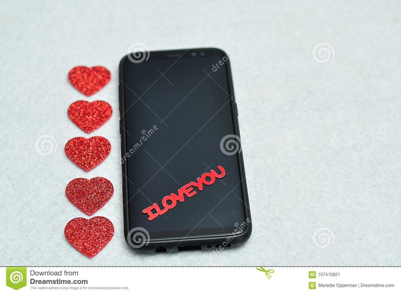 Download A Smart Phone Displayed With The Words I Love You And Hearts Stock Image