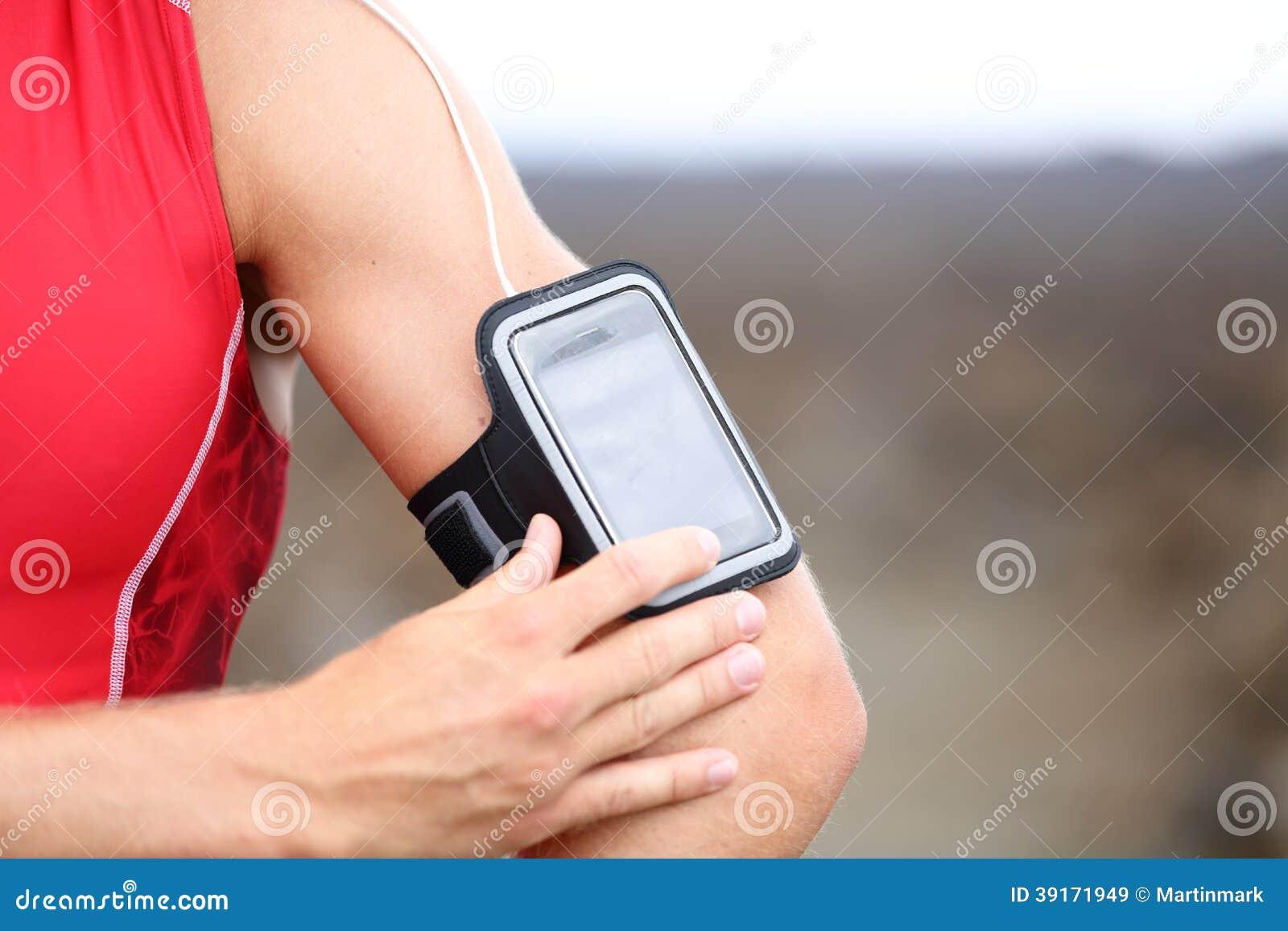 Smart phone running music closeup - male runner