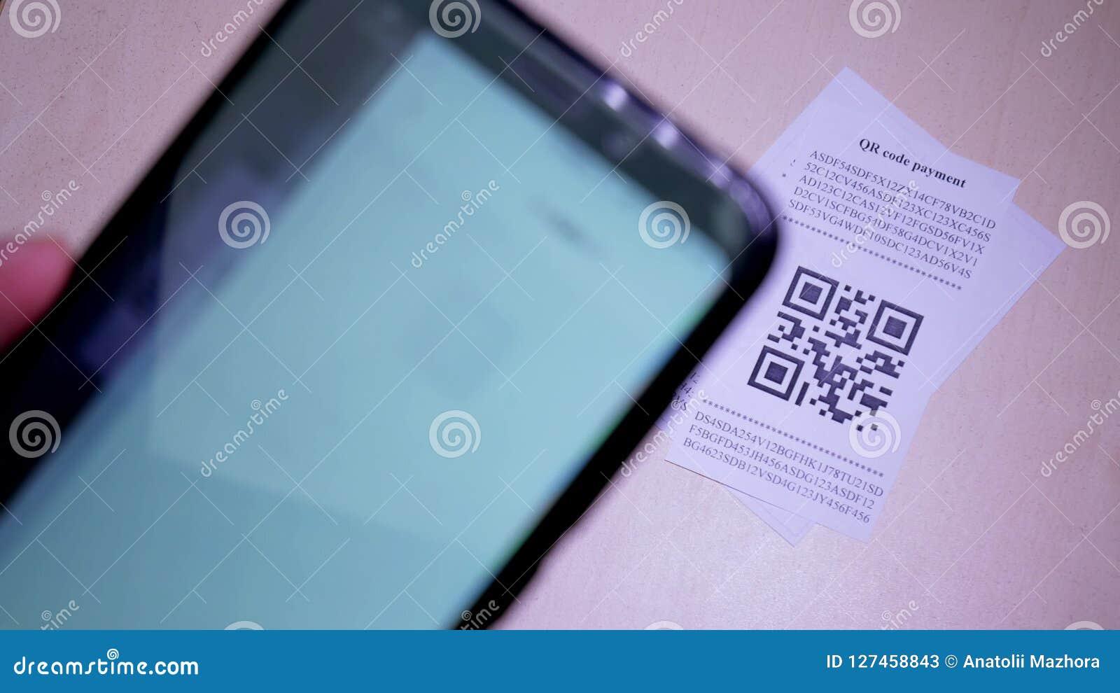 Smart phone scanning QR code in paper label