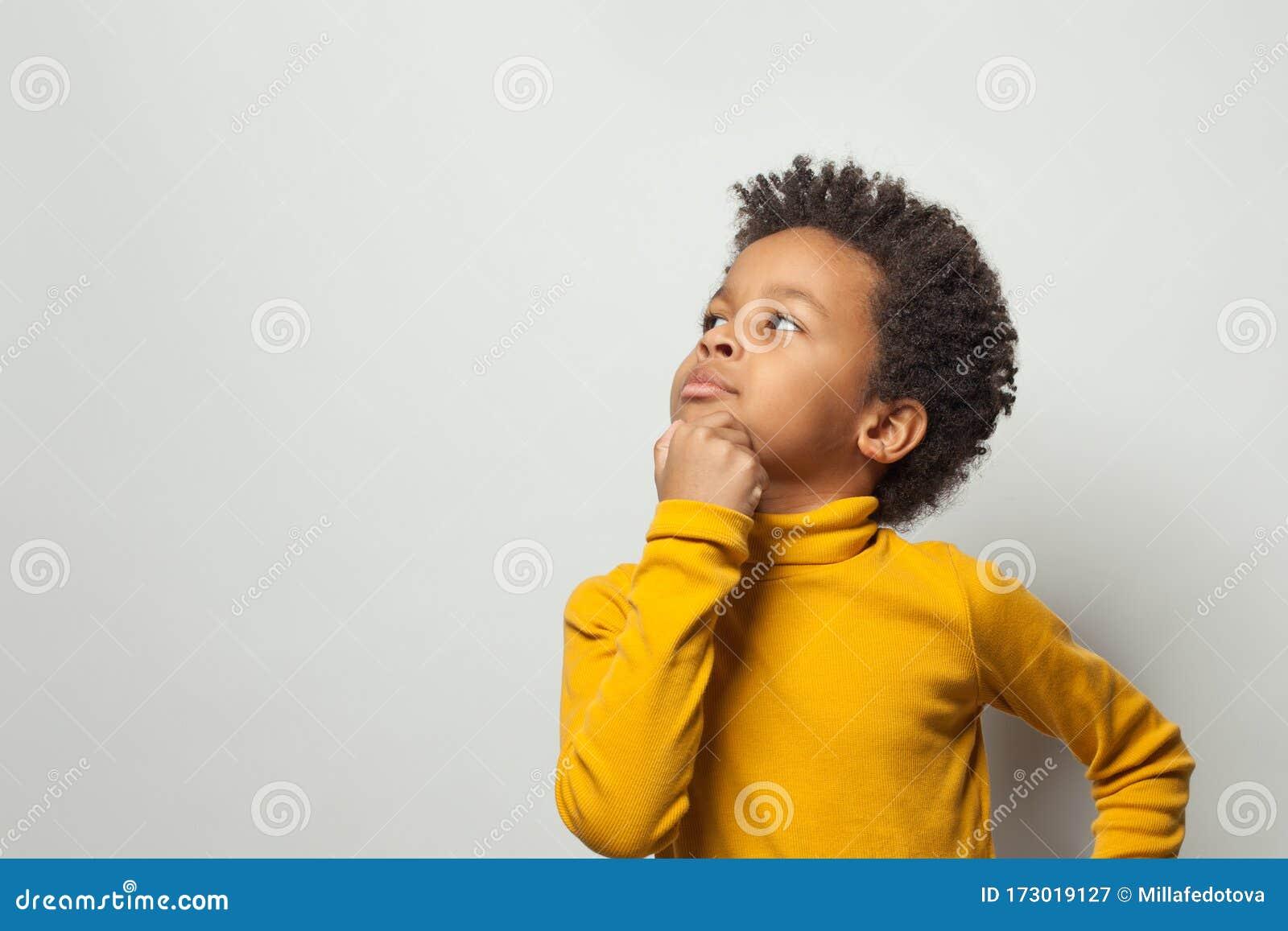 smart schoolboy black kid boy thinking white background 173019127