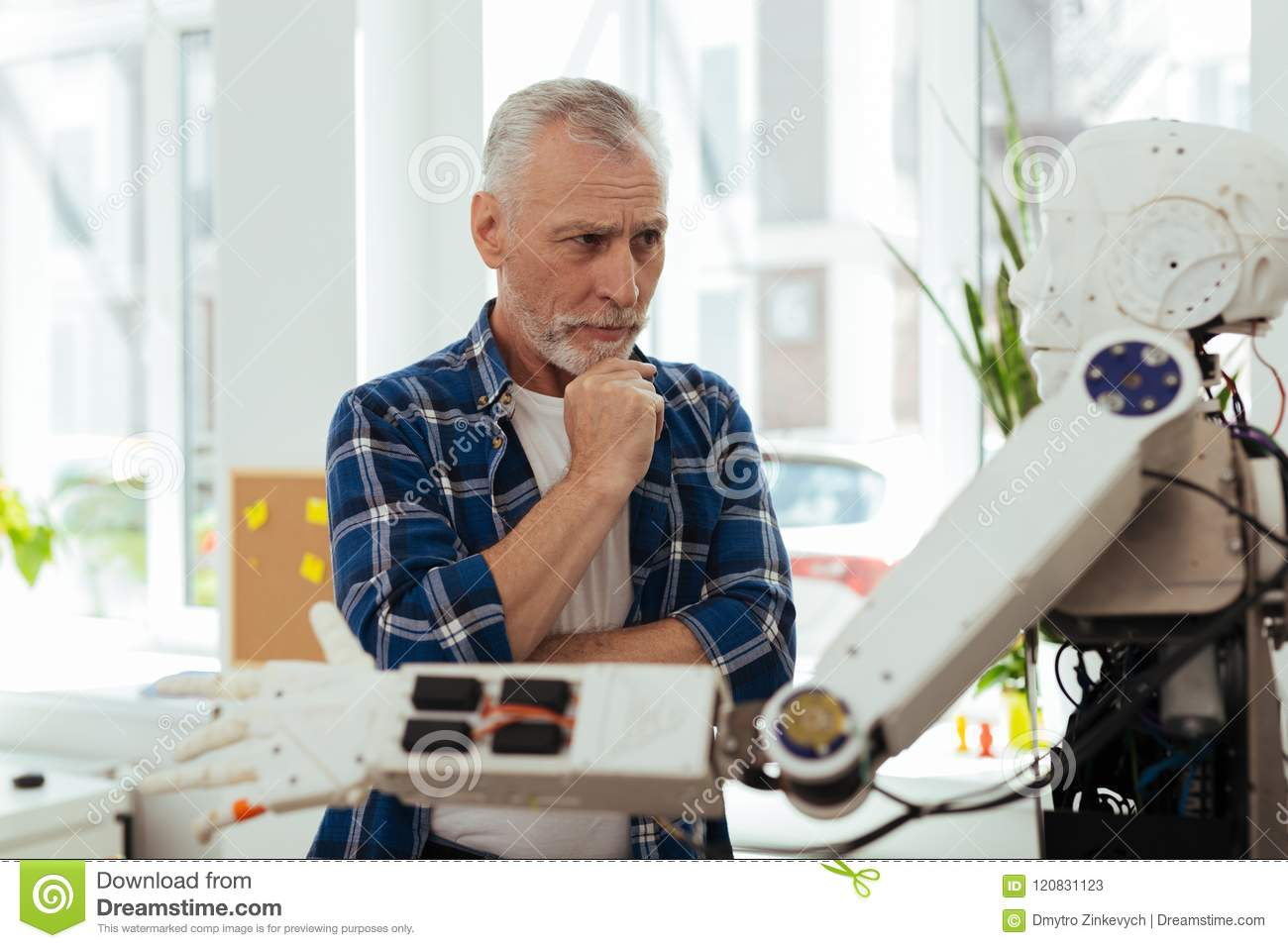 Serious thoughtful man looking for new ideas