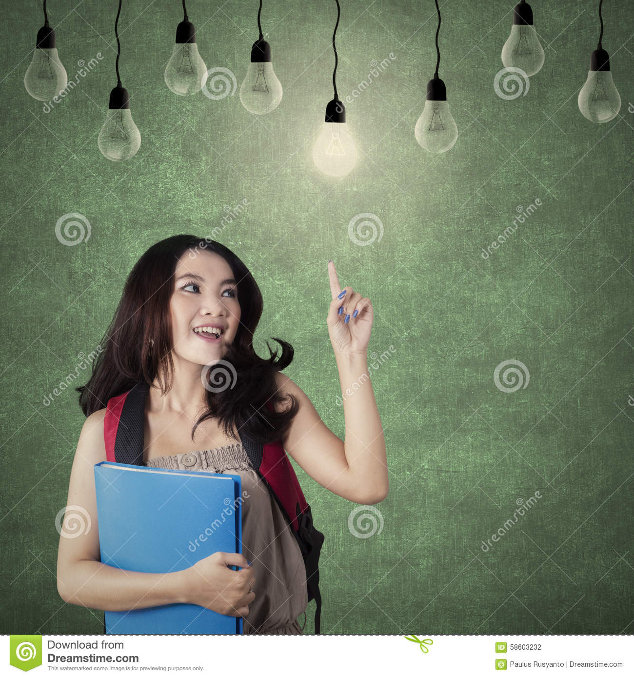 Clever School Girl: Smart Student Choosing A Bright Light Bulb Stock Photo