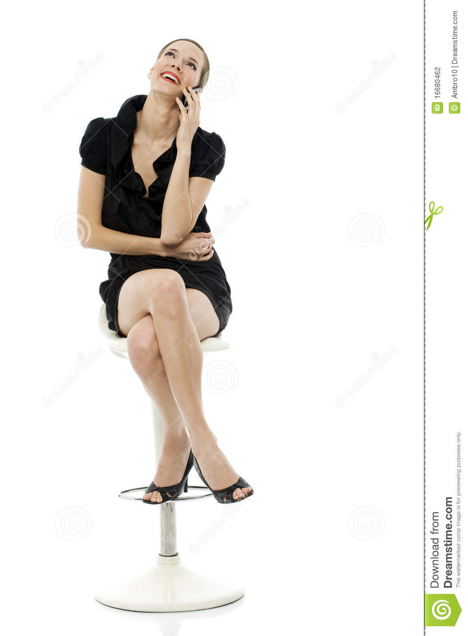 Smart Woman Sitting On A Stool Holding A Cellphone Stock Photography Image 16680462