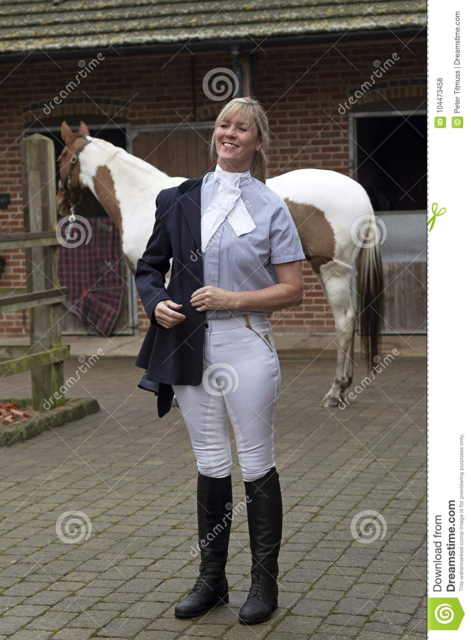 Woman Horse Rider Getting Dressed In A Blue Jacket Stock Photo Image Of Equestrian Portrait 104473458
