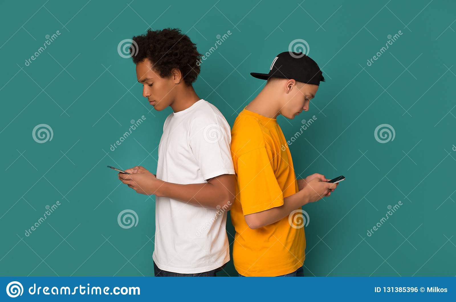 Smartphone addiction. Friends standing back to each other