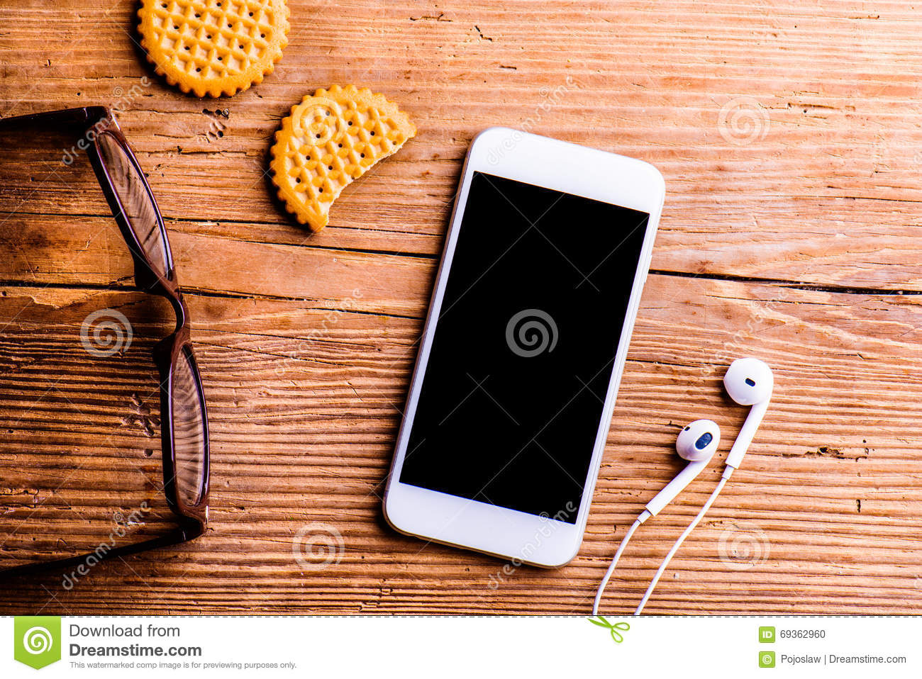 Smartphone, Earphones, Eyeglasses And Other Objects On ...
