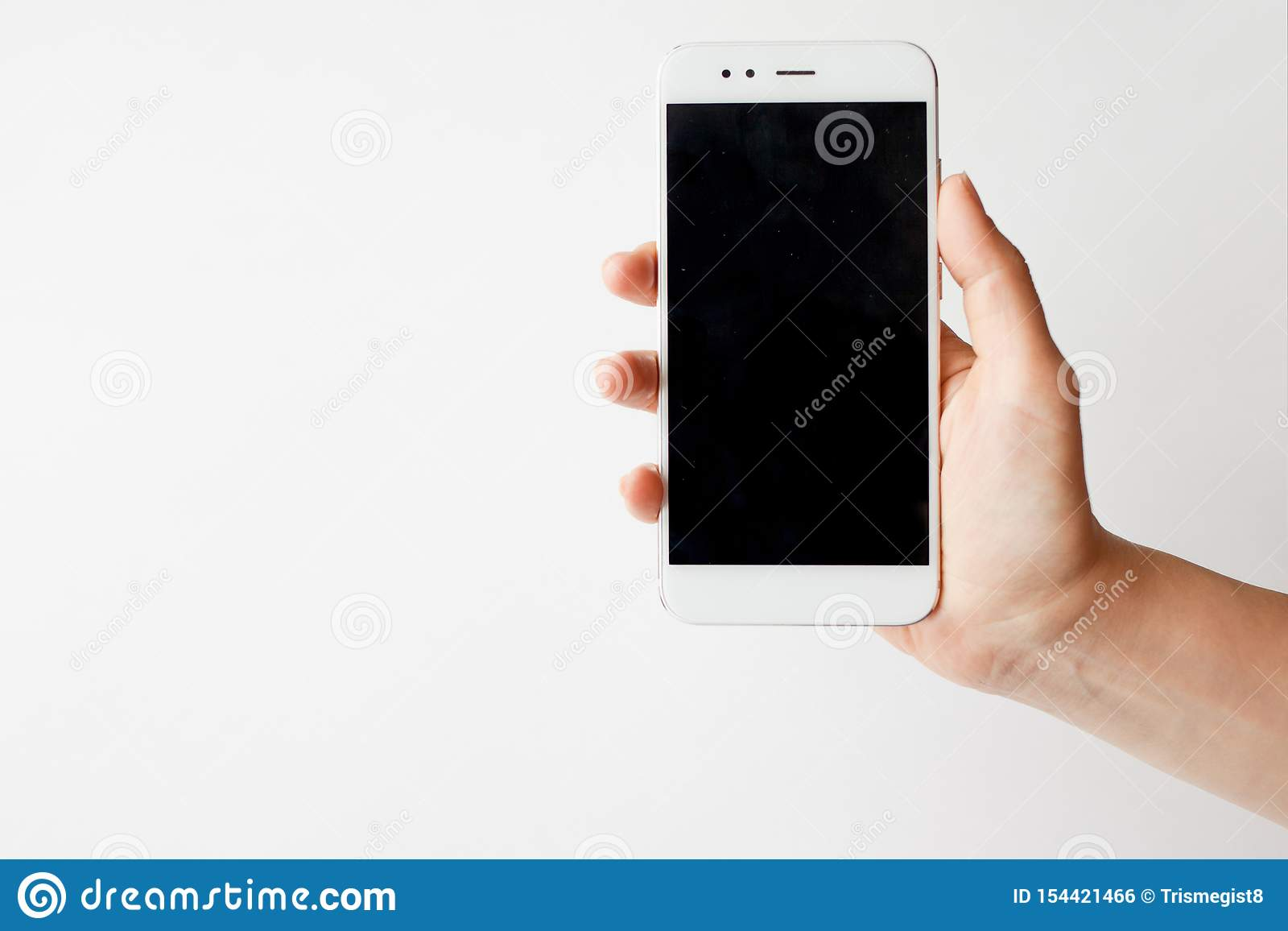 Smartphone in hand, blank screen mock up on white background
