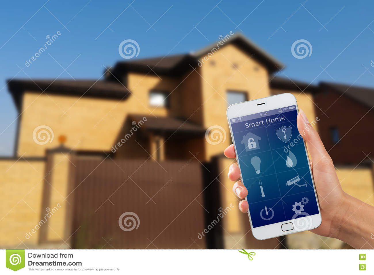 Smartphone With Home Security App In A Hand On The Building