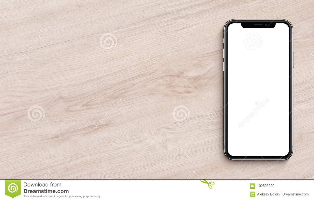 Smartphone similar to iPhone X mockup flat lay top view lying on wooden office desk banner with copy space