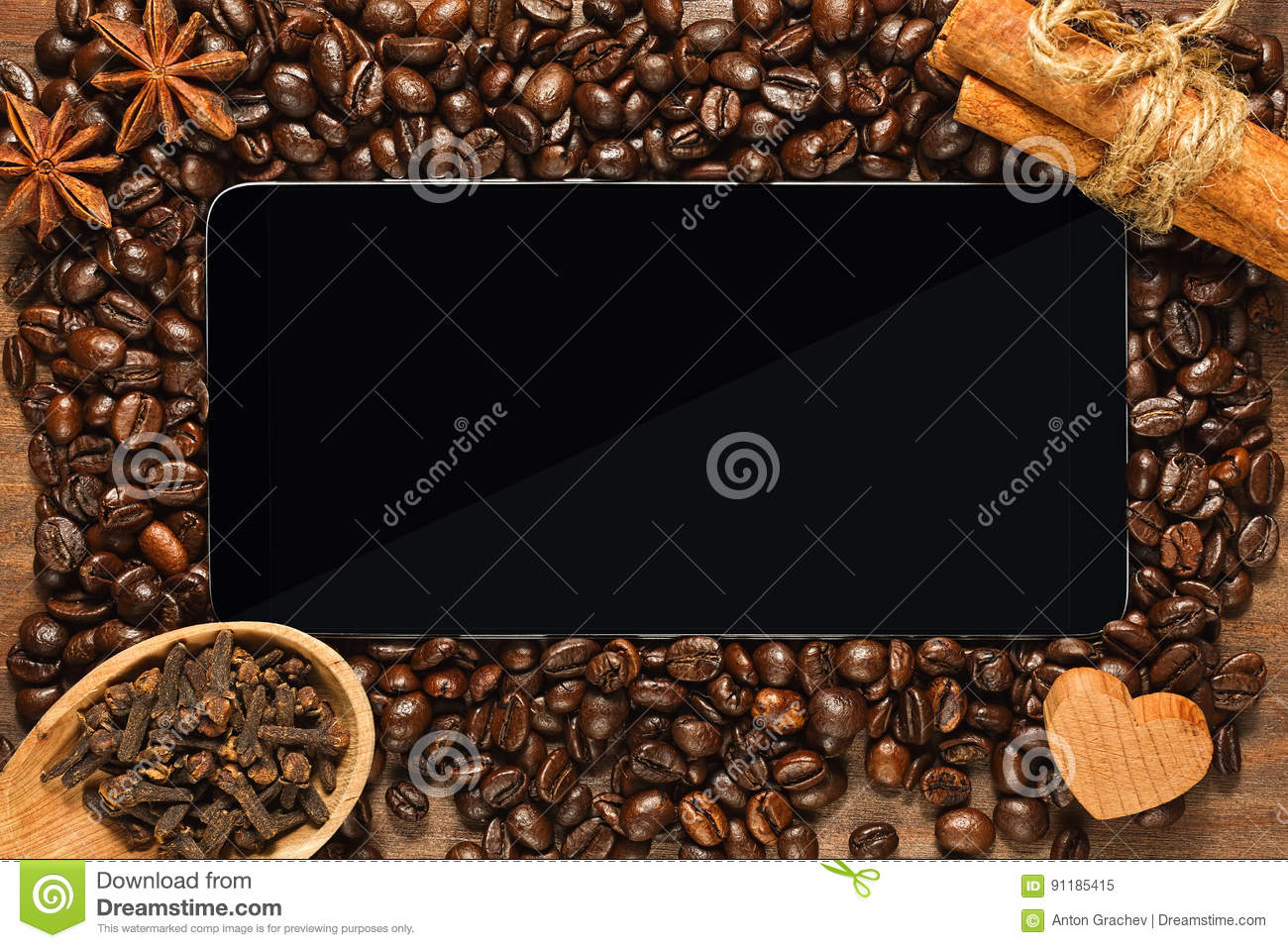 Smartphone or tablet with frame of coffee beans and condiments