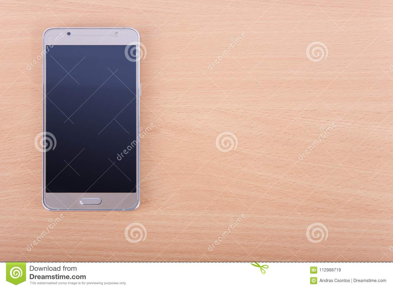 Smartphone on a wooden office table.