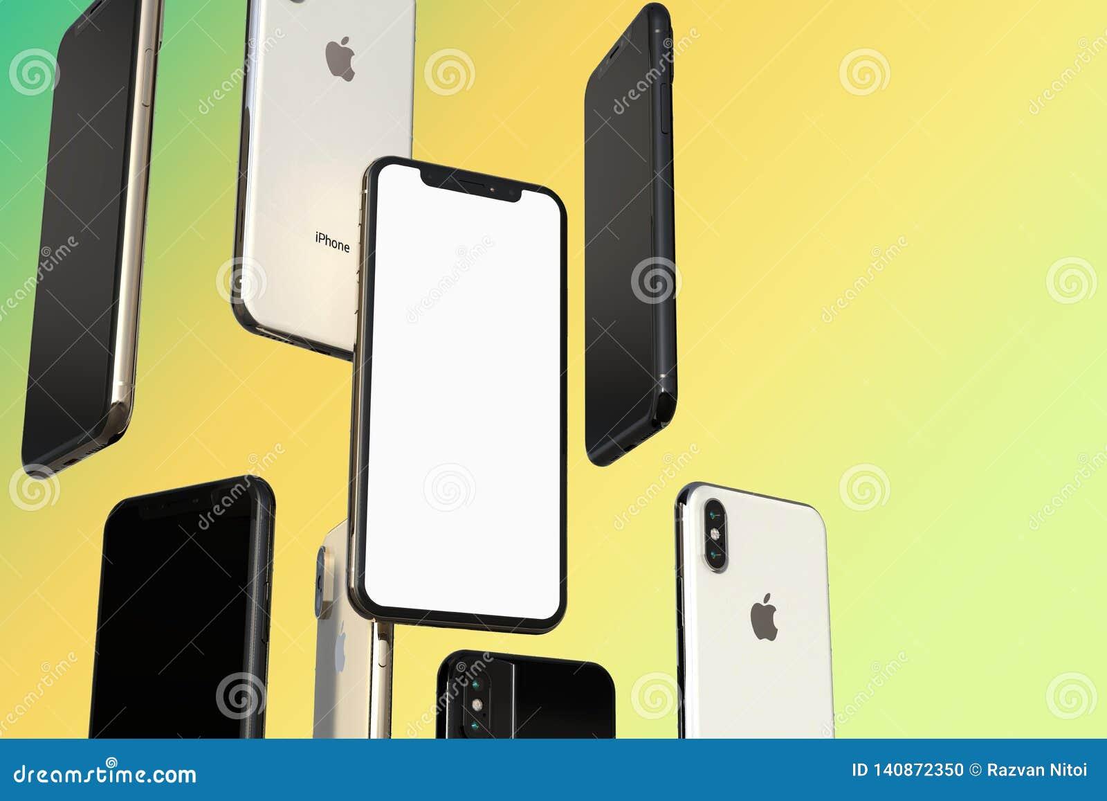 Smartphones cinzentos do ouro, da prata e do espaço de IPhone XS, flutuando no ar, tela branca