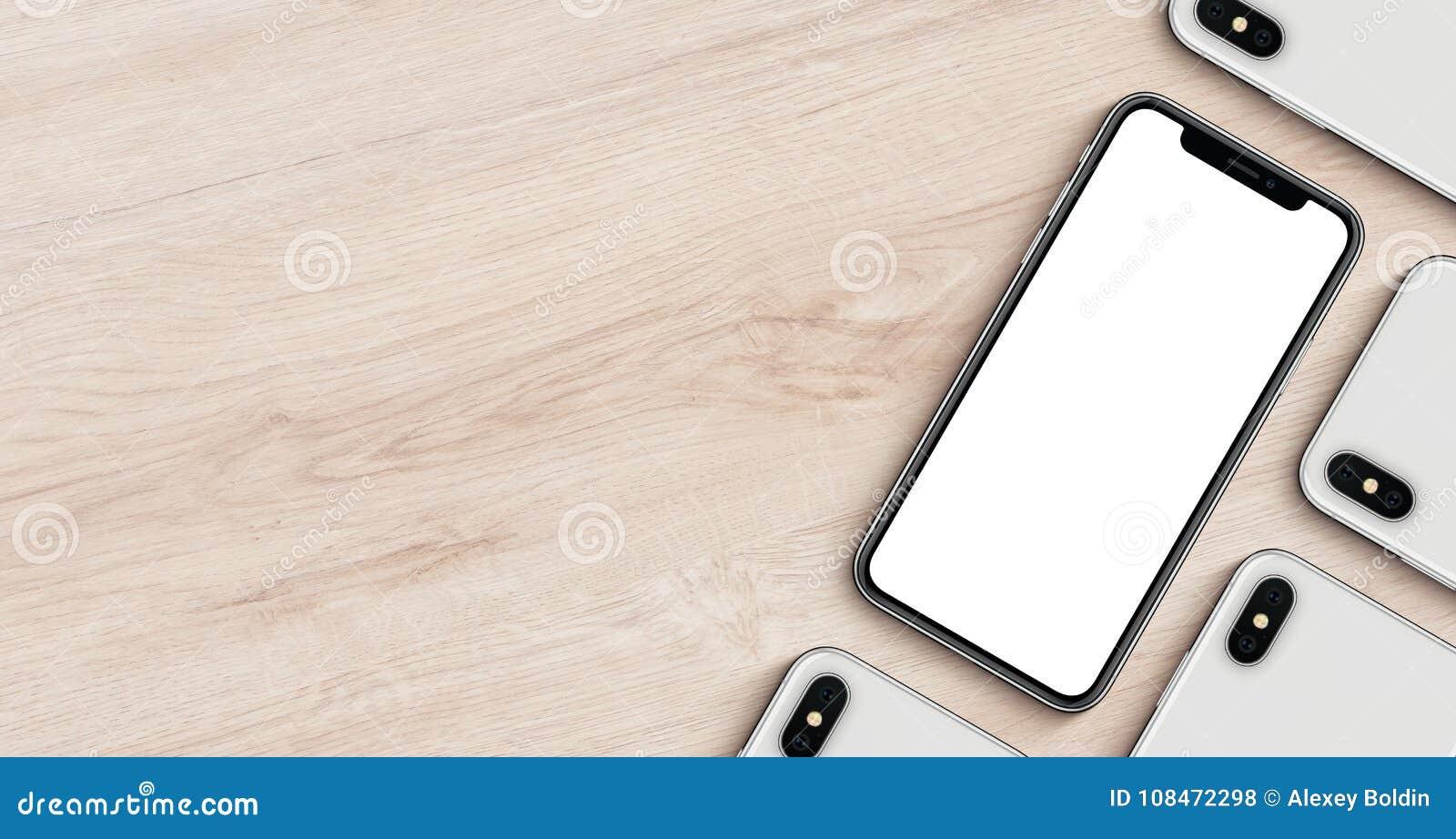 Smartphonesmodellbaner med den lekmanna- bästa sikten för copyspacelägenhet som ligger på träkontorsskrivbordet