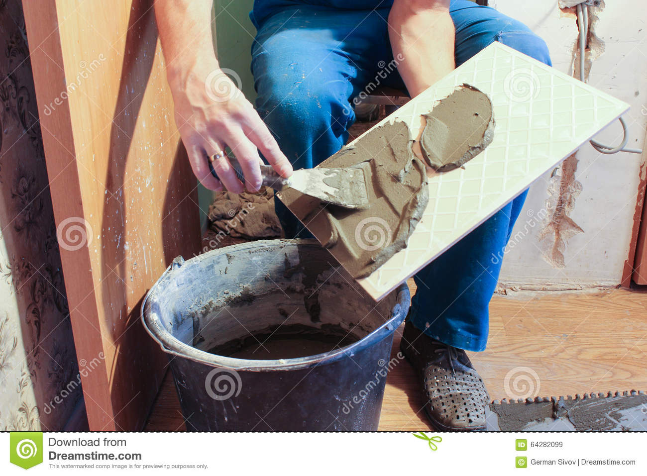 Smearing Glue On The Tile Trowel  Stock Image - Image of