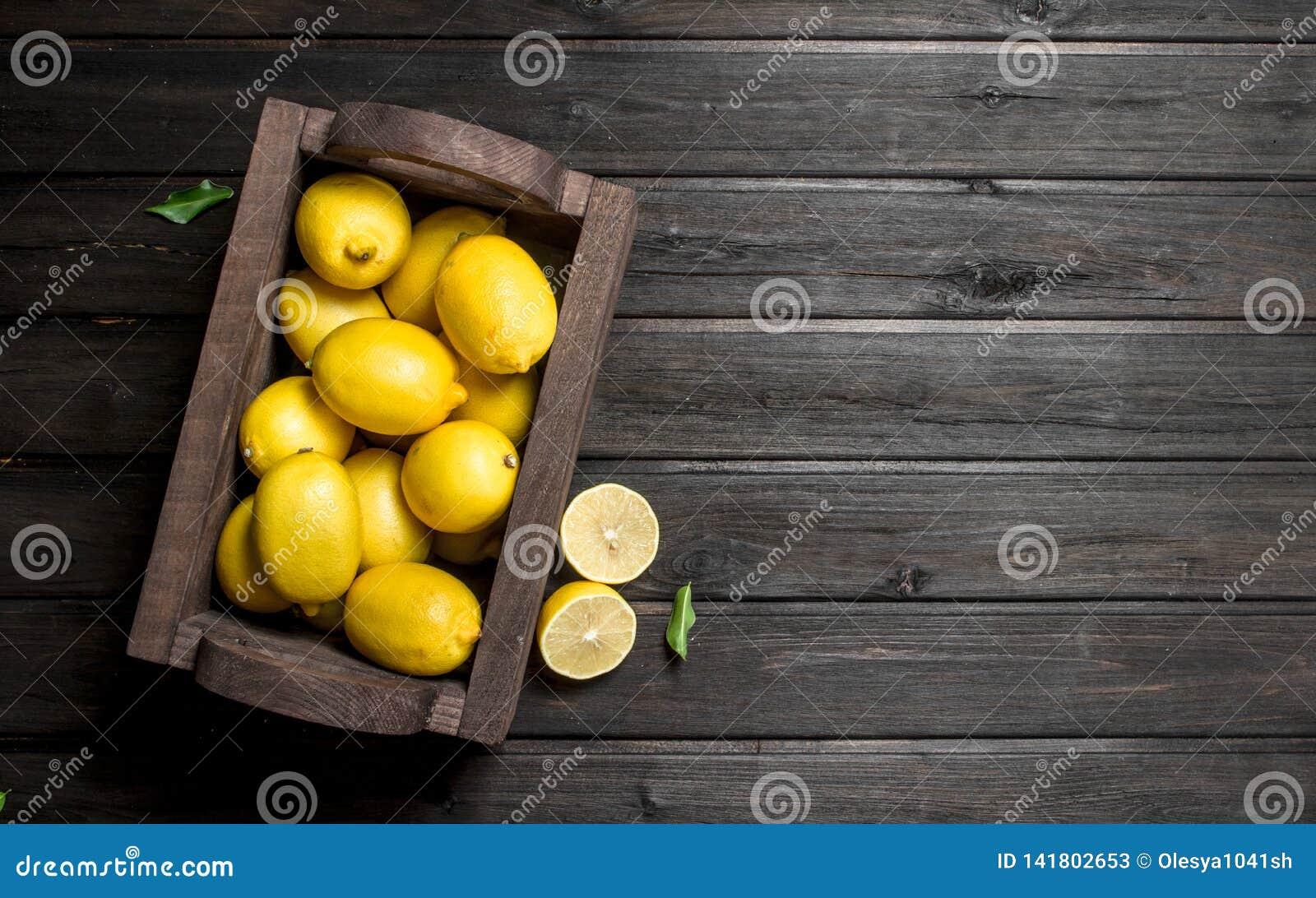 The smell of fresh lemons in wooden box