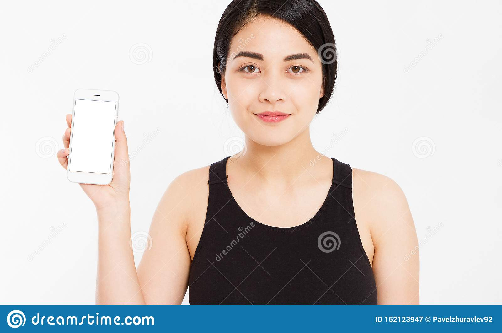 Smile asian girl show empty blank screen mobile phone - pointed on empty display device