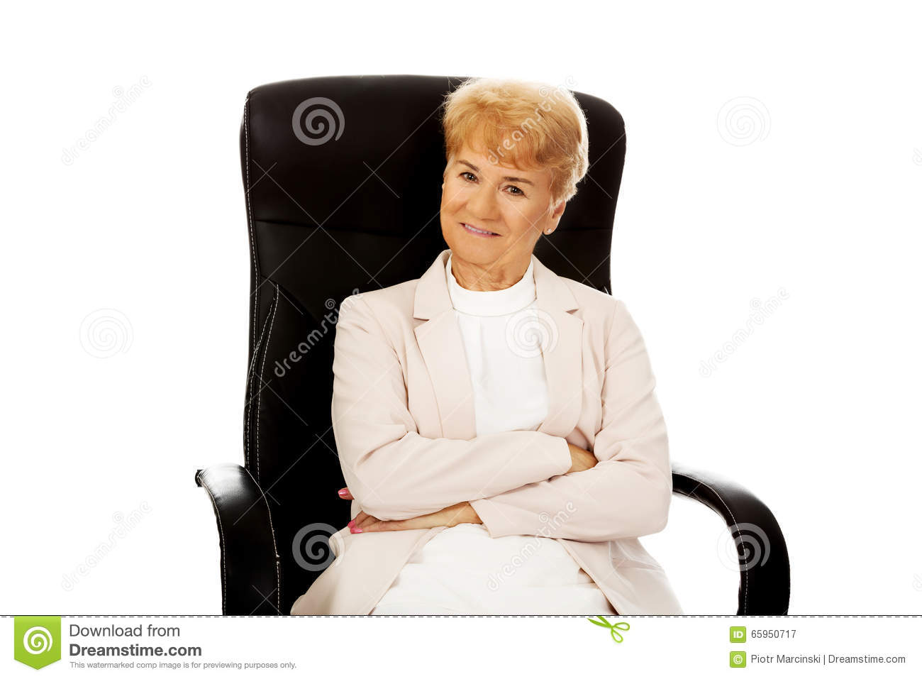 Smile elderly business woman sitting on armchair stock for Sitting in armchair