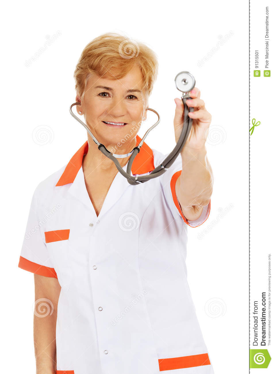 Smile elderly female doctor holding stethoscope
