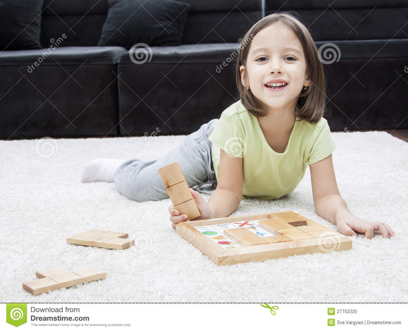 Smile Girl Playing On The Floor Royalty Free Stock Photo