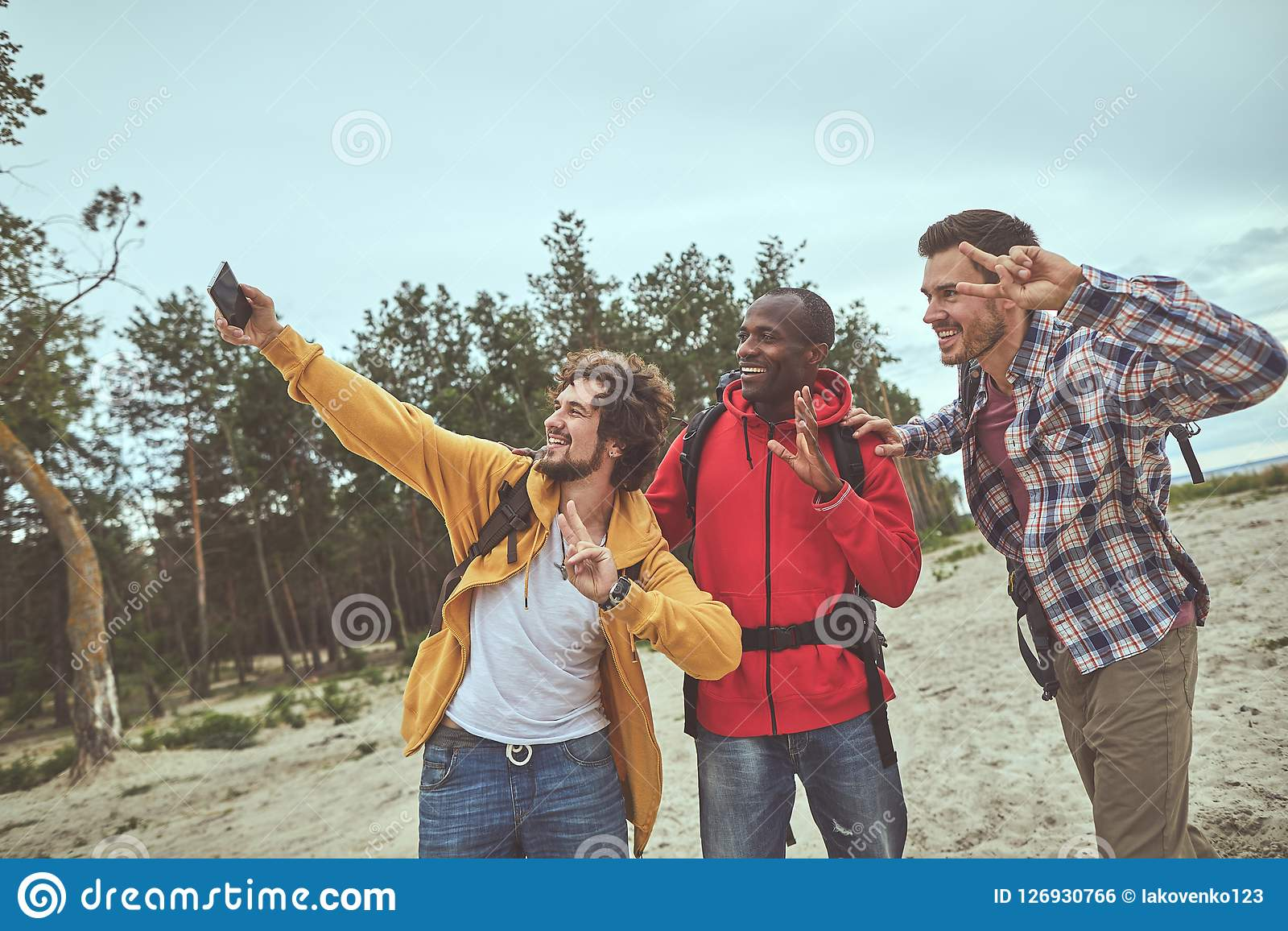 Smile guys using gadget during holiday journey
