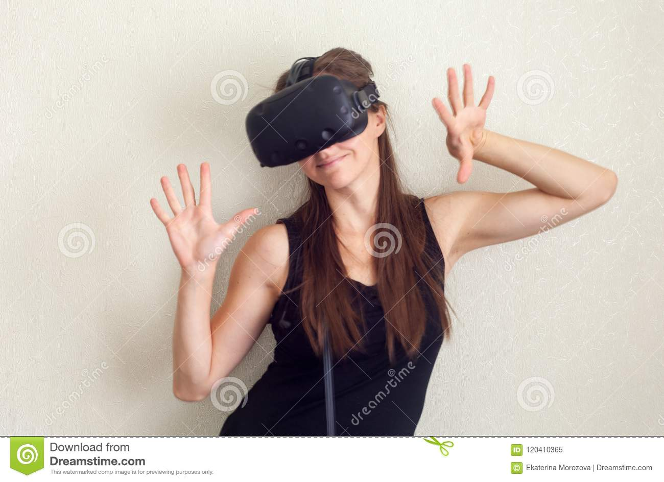 e3d384b026ce Smile happy woman getting experience using VR-headset glasses of virtual  reality at home much gesticulating hands
