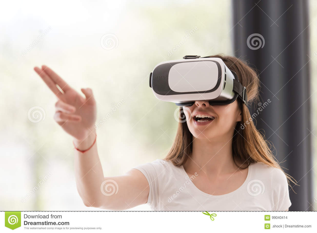 Woman Using VR-headset Glasses Of Virtual Reality Stock