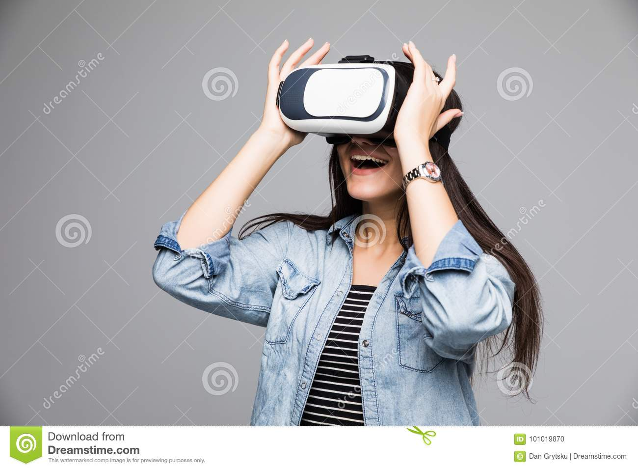 23f28a00f73a Smile happy woman getting experience using VR-headset glasses of virtual  reality much gesticulating hands on gray background