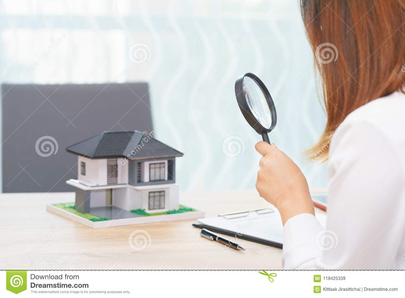 Smile woman searching for new home or inspecting homes before bu