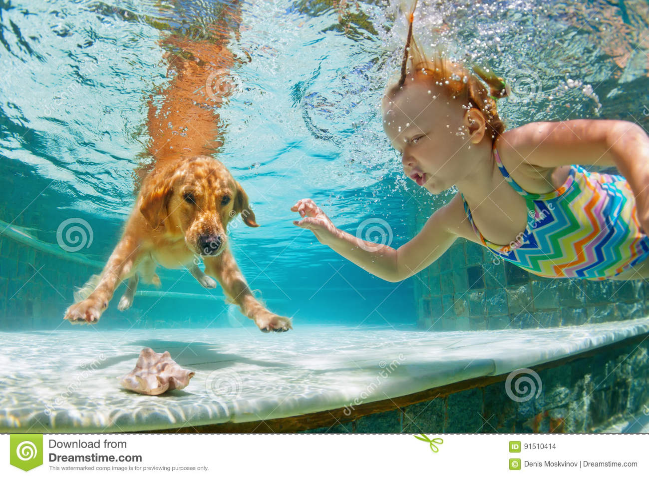 Smiley child with dog in swimming pool. Funny portrait.
