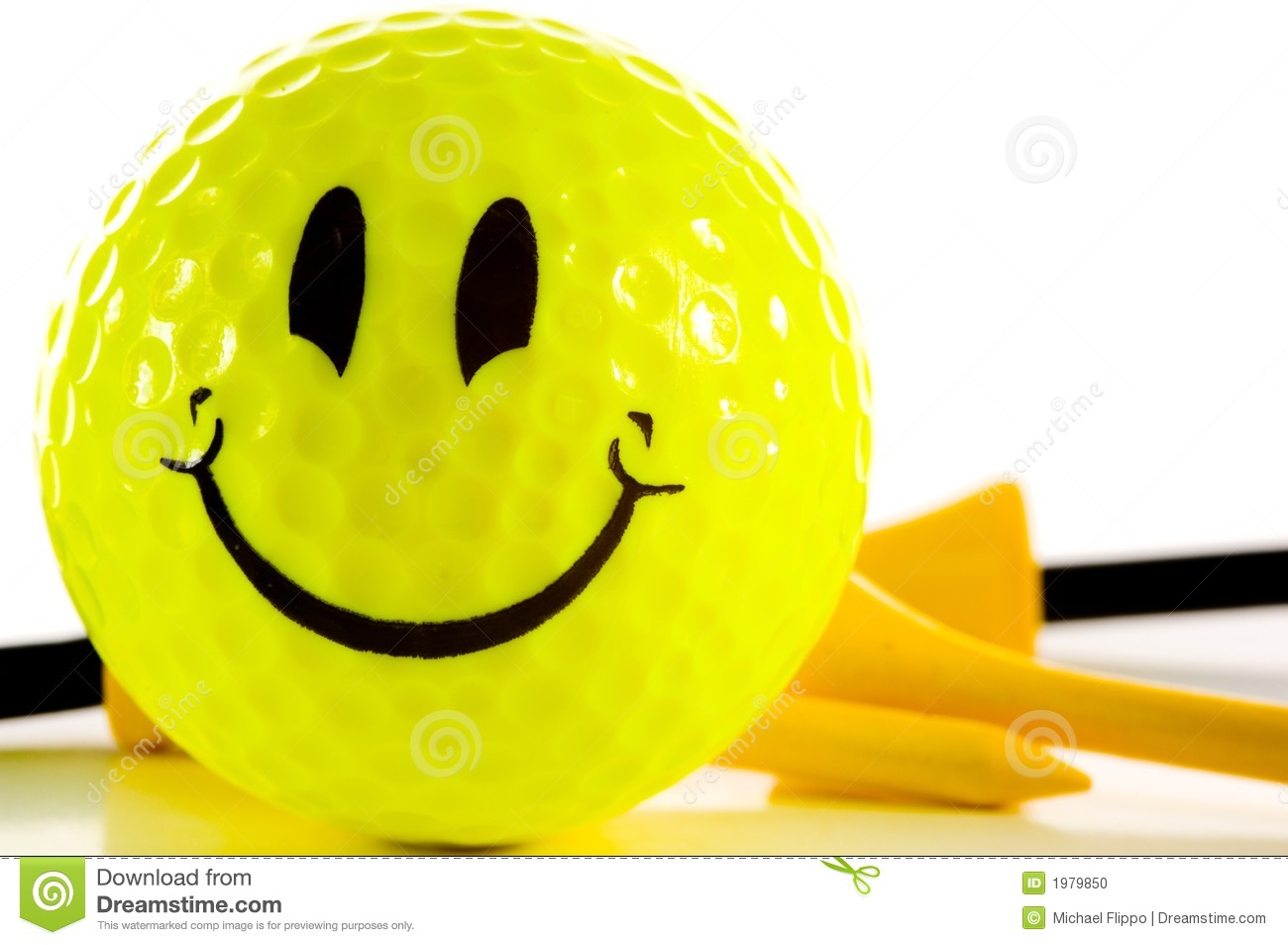 Yellow smiley face golf ball on white background with yellow and black ...