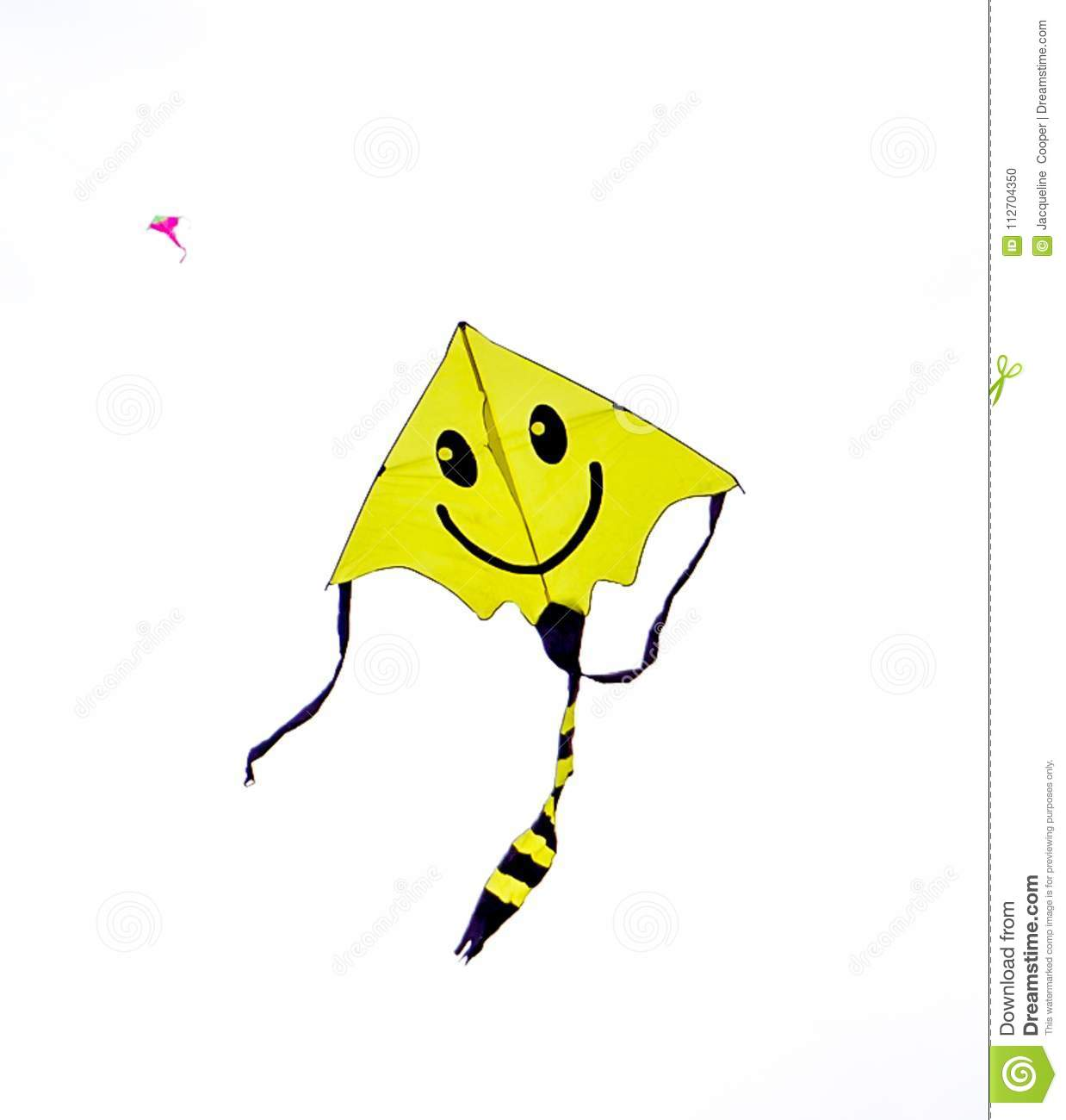 Smiley Face Kite Flying In A Cloudy Skiy Stock Photo Image Of Blue