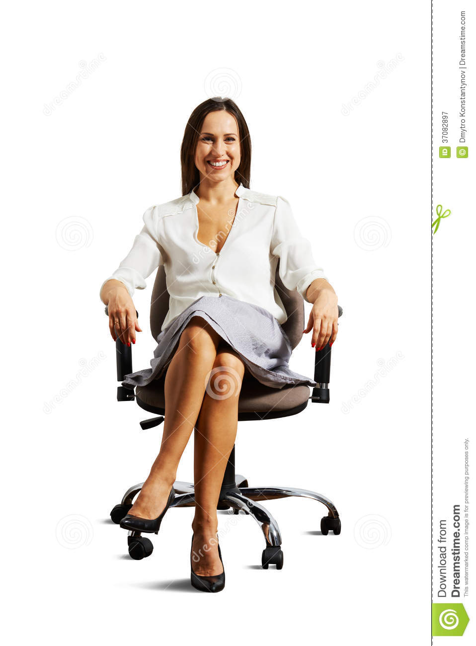 smiley woman sitting on the office chair royalty free stock photography