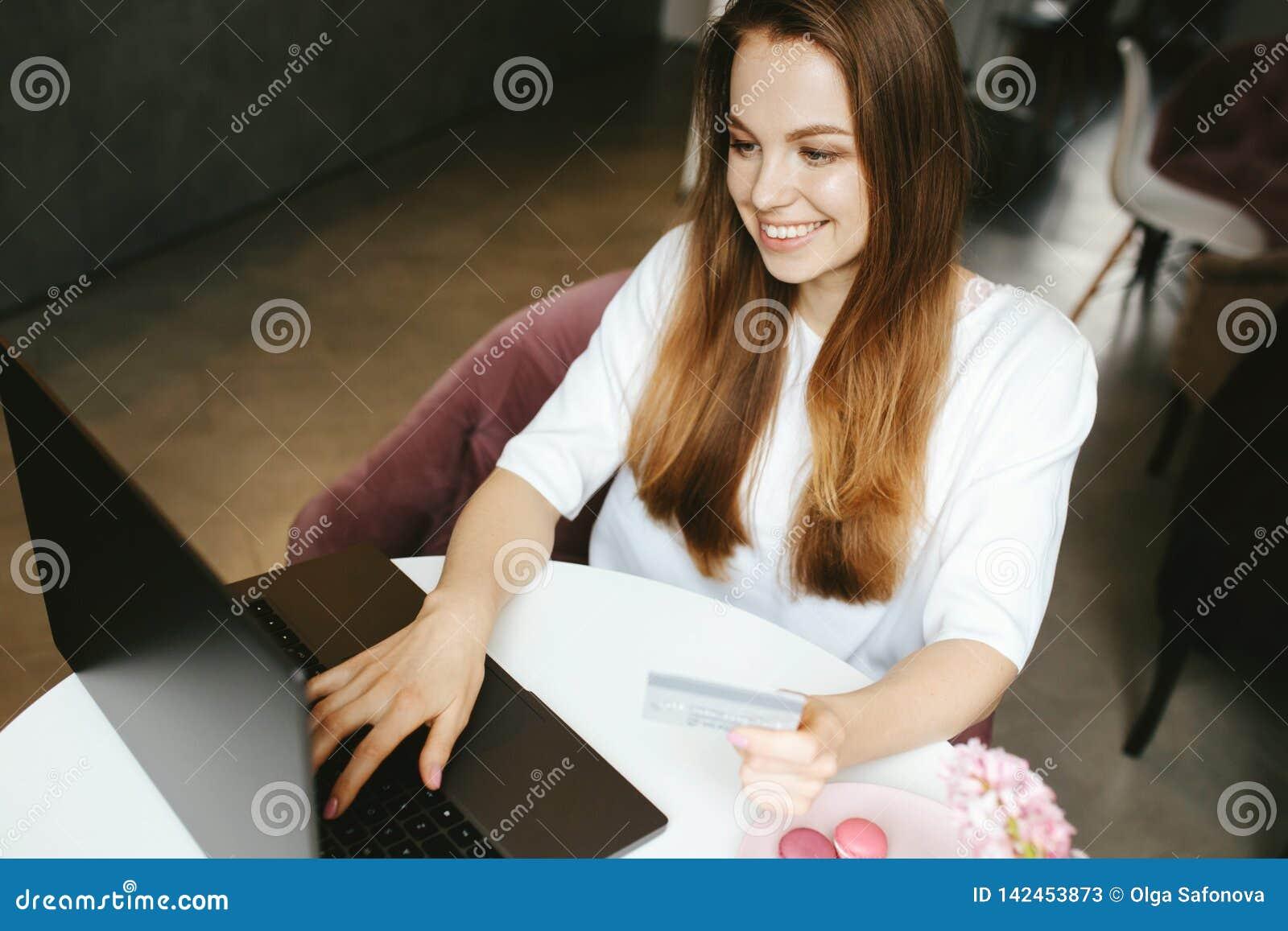 Smiley girl typing on laptop keyboard