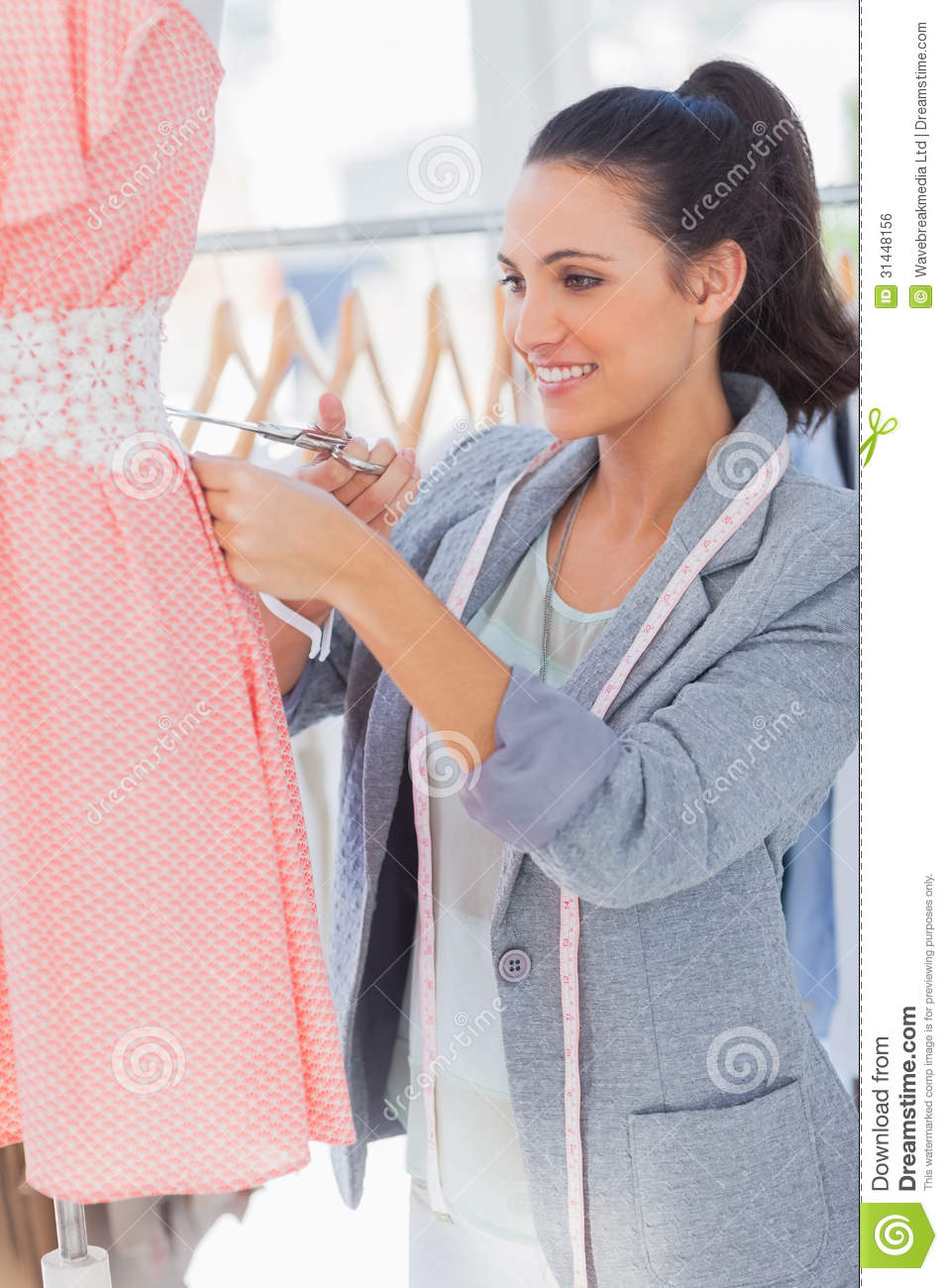 Smilig fashion designer cutting dress royalty free stock for To be a fashion designer