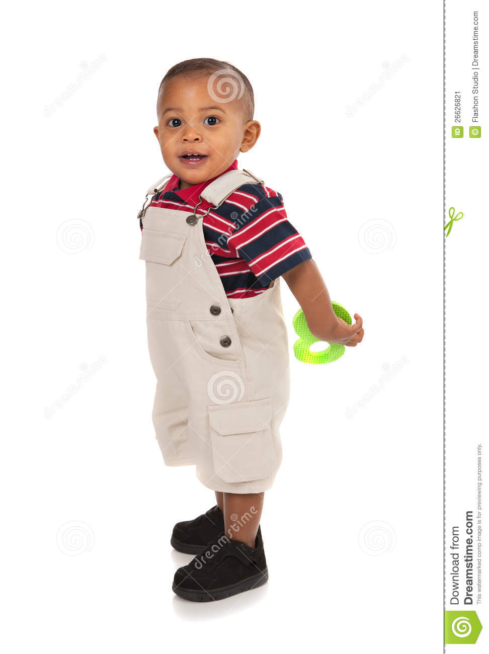 Smiling 1 Year Old Baby Boy Standing Holding Toy Stock