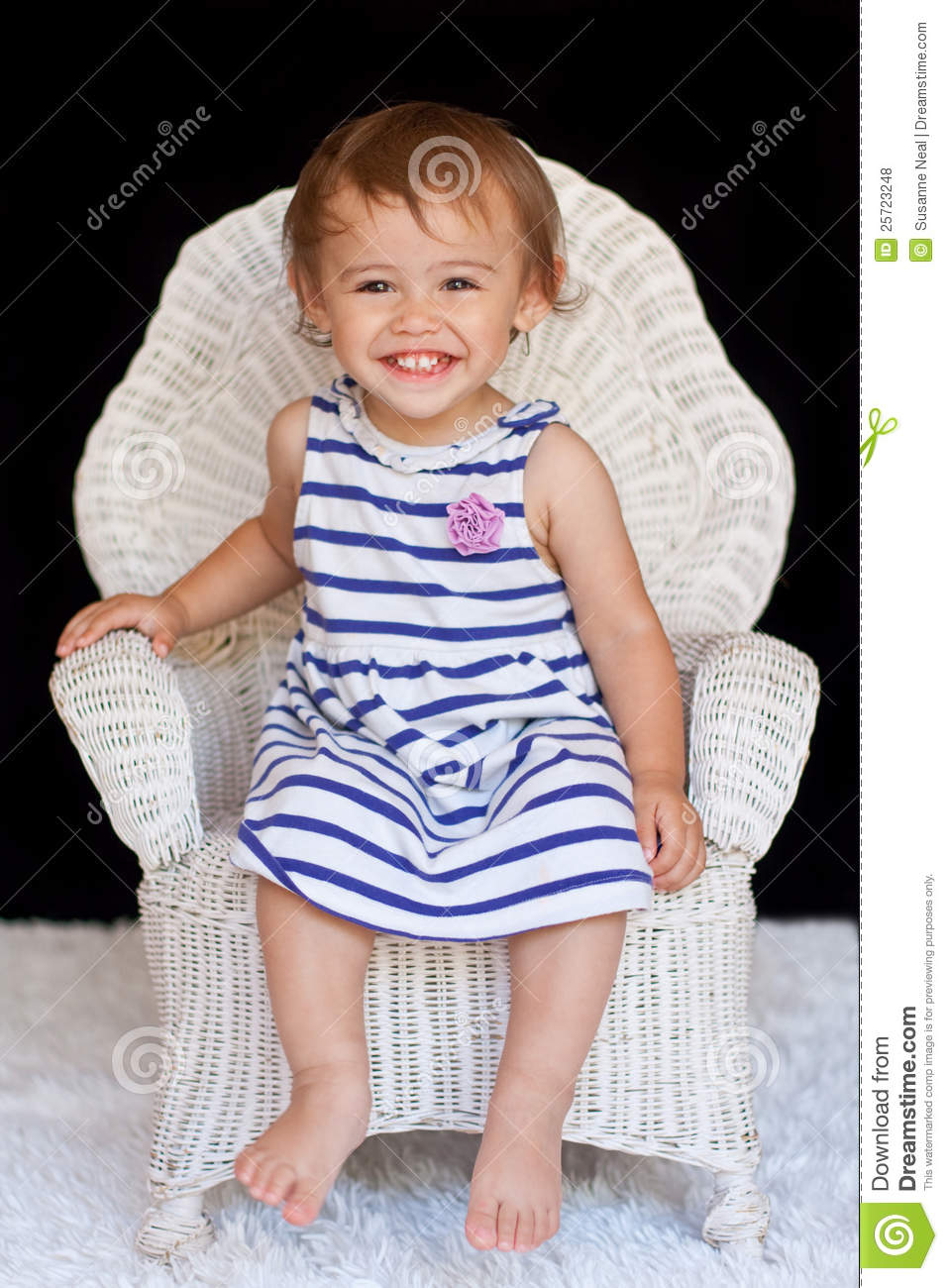 Smiling 1 Year Old Multicultural Girl In Chair Royalty