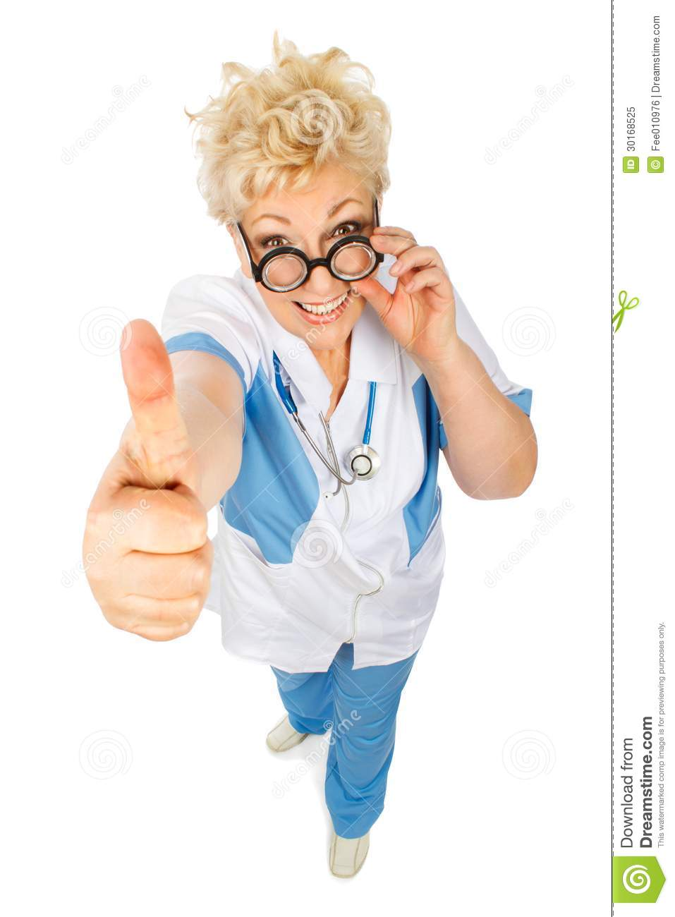 Smiling adult woman doctor shows thumb in camera